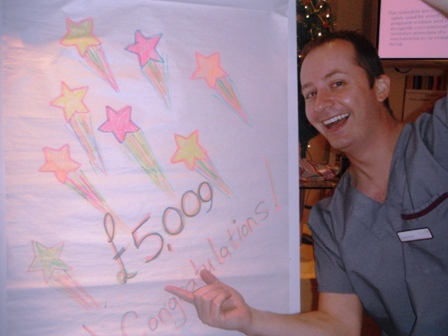 """""""Andrew proudly showing the amount raised during 2012"""""""